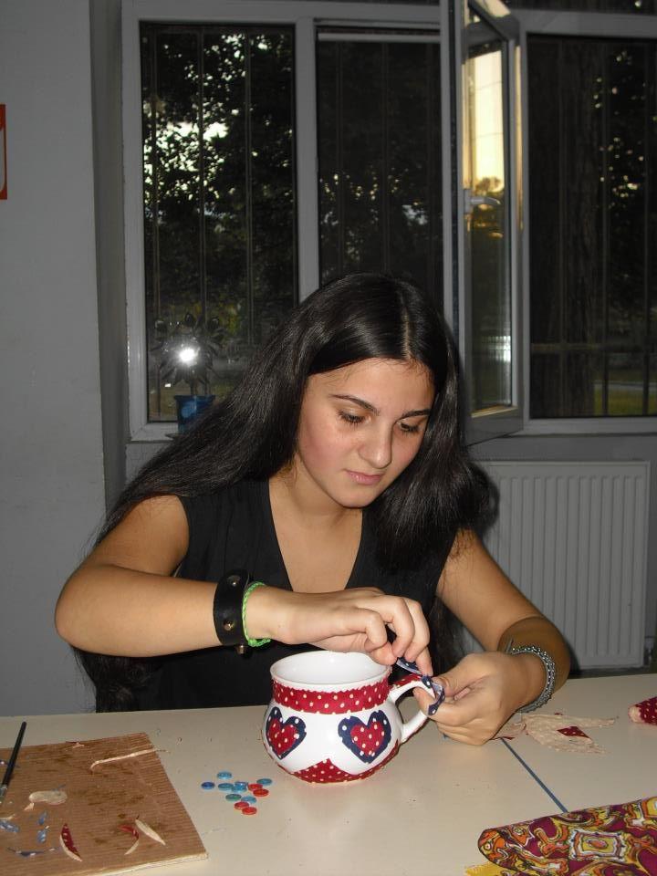 Rustavi, October 18, 2012-Nini decorating a mug during a GYE organized Art Workshop