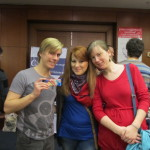 Tomash, Beata, and Jana pose between GYE's and Cartlosi's booths
